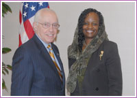 Mildred Muhammad with Attorney General Michael B. Mukasey